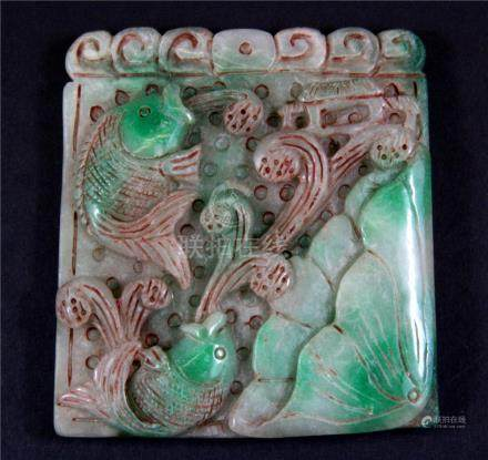 A Chinese carved jade/hardstone panel of a fish in a lotus pond, size 8.5 x 9.5cm.