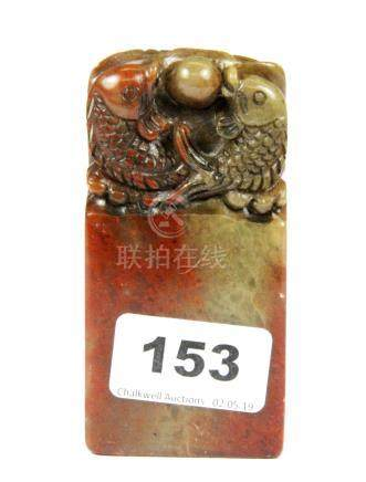 A mid 20th century Chinese carved soapstone seal, H. 10cm.