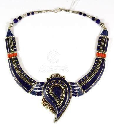 A Tibetan white metal and lapis lazuli necklace.
