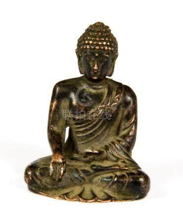 A small Tibetan copper bronze figure of the seated Buddha, H. 5cm.