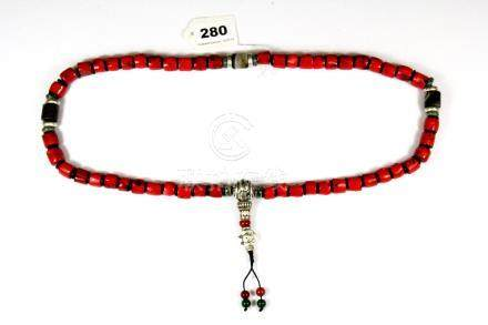 A strand of Tibetan coral, agate and white metal prayer beads, bead size 1cm folded L. 47cm.