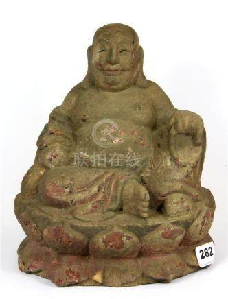 A Chinese carved wooden figure of the seated happy Buddha, H. 25cm.