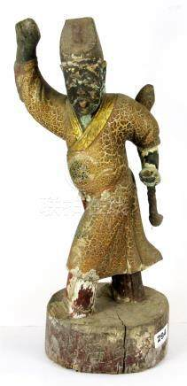 A 19th Century Chinese Qing dynasty carved wooden figure with painted decoration, H. 47cm. Prov.