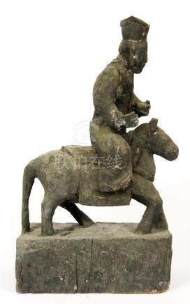 A Chinese Qing dynasty carved wooden figure riding a horse, H.35cm. Prov. Private Collection.