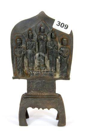 A Chinese cast iron Buddhist temple figure featuring the Buddha flanked by two Guanyin and two