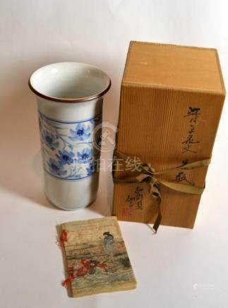 A Japanese blue and white porcelain vase, signed to base, boxed with Gallery 119, Tokyo label verso;