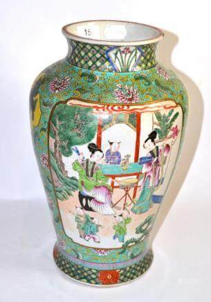A Chinese famille vert vase decorated with figures, with later qing long marks (a.f.)