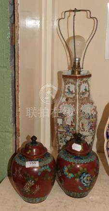 A Chinese vase (drilled); and a pair of cloisonne jars and covers