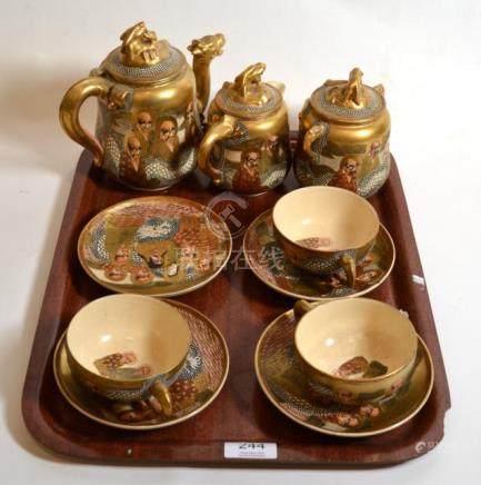 A Japanese Satsuma part tea service decorated with sages, circa 1890/1900