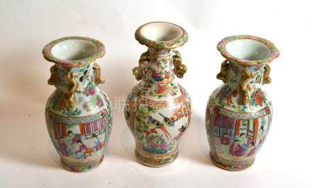 A pair of Chinese famille rose vases; and a similar example (3)