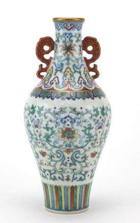 Chinese porcelain doucai vase with iron red handles, finely hand painted with flower heads amongst