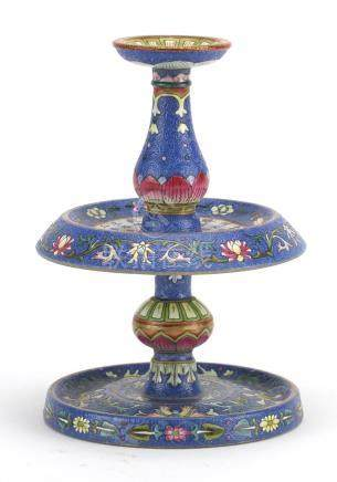 Good Chinese blue ground porcelain candlestick, finely hand painted in the famille rose palette with