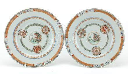 Pair of Chinese porcelain plates, each hand painted with a central roundel enclosing a landscape