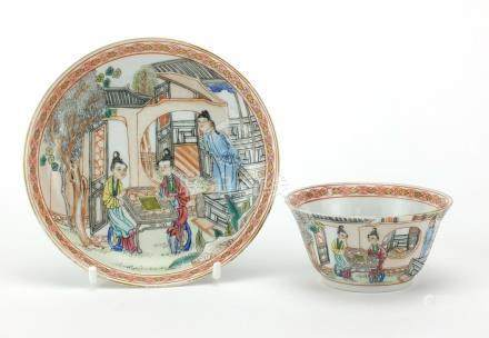 Chinese porcelain tea cup and saucer, finely hand painted in the famille rose palette with figures