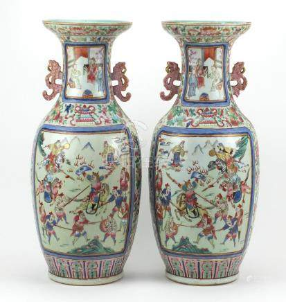 Large pair of Chinese Canton porcelain vases with twin handles, each hand painted in the famille