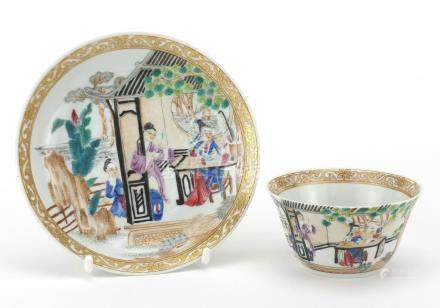 Chinese porcelain tea cup and saucer, hand painted in the famille rose palette with figures in a