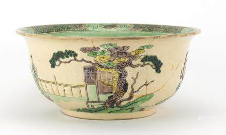 Chinese famille verte pottery bowl, decorated in low relief with figures in a palace setting, six