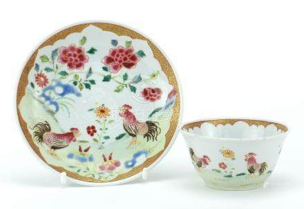 Chinese porcelain tea bowl and saucer, finely hand painted in the famille rose palette with