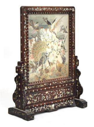 A 19th century Chinese Hongmu mother of pearl inlaid table screen on stand inset with a silk panel