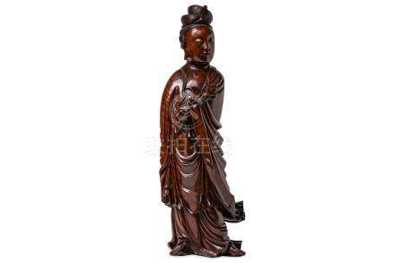 A LARGE CHINESE HARDWOOD FIGURE OF GUANYIN.