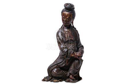 A CHINESE WOOD GILT-LACQUER FIGURE OF GUANYIN.