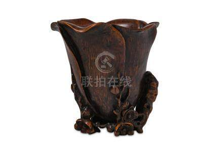 A CHINESE BAMBOO 'MAGNOLIA' LIBATION CUP.