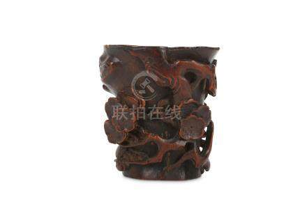 A CHINESE BAMBOO 'PRUNUS' LIBATION CUP.
