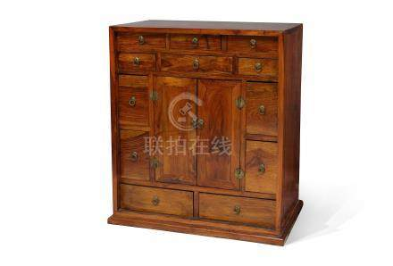A CHINESE HUANGHUALI MEDICINE CHEST.
