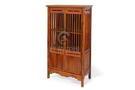 A CHINESE HUANGHUALI CABINET.