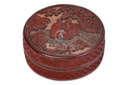 A CHINESE CINNABAR LACQUER CIRCULAR BOX AND COVER.