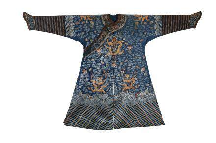 A CHINESE EMBROIDERED BLUE-GROUND 'DRAGON' ROBE, JIFU.