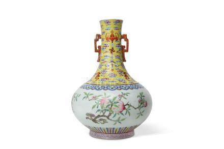A CHINESE FAMILLE ROSE BOTTLE VASE.