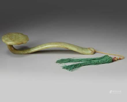 A Chinese celadon jade ruyi sceptre