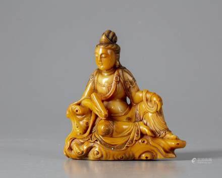 A Chinese soapstone figure of Guanyin