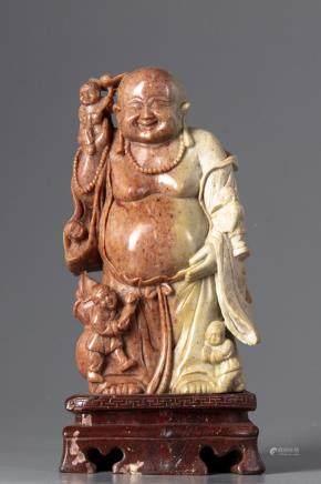 A Chinese soapstone figure of Budai