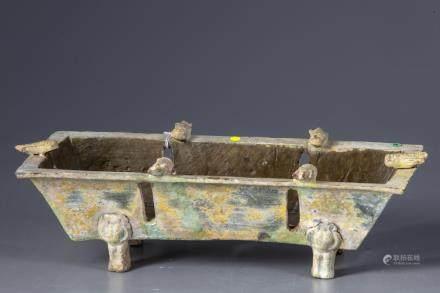 A terracotta brazier with cicada's .