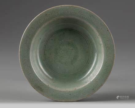 A Korean celadon-glazed carved stem dish