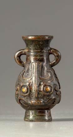A bronze miniature vase, hu