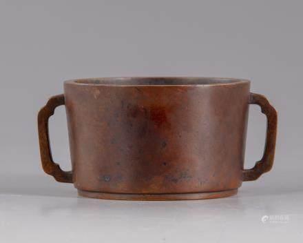 A Chinese bronze circular censer