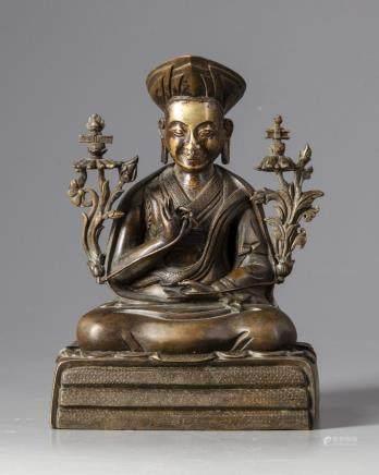 A partial gilt Chinese bronze buddha figure