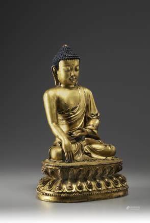 A Chinese gilt bronze figure of Buddha Shakyamuni.