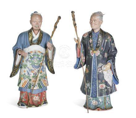 A pair of Chinese Export painted clay 'nodding head' figures, Qing Dynasty, early 19th century