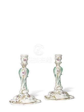 A pair of Meissen porcelain table candlesticks