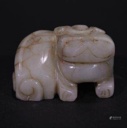A CARVED HETIAN JADE ORNAMENT OF LION