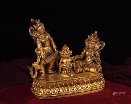 A GILT-BRONZE FIGURE OF TWO BUDDHAS