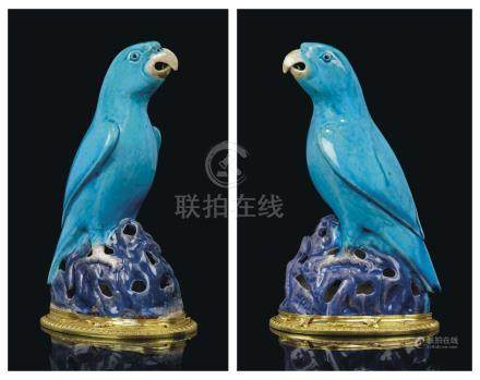 A PAIR OF EARLY LOUIS XV ORMOLU-MOUNTED PARROTS