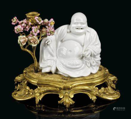 A FRENCH ORMOLU-MOUNTED BLANC-DE-CHINE AND CONTINENTAL PORCELAIN GROUP