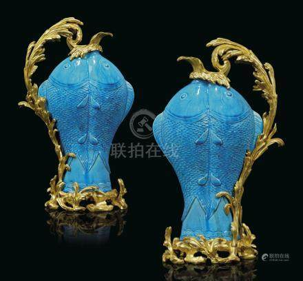 A PAIR OF FRENCH ORMOLU-MOUNTED CHINESE TURQUOISE-GLAZED PORCELAIN TWIN-CARP EWERS