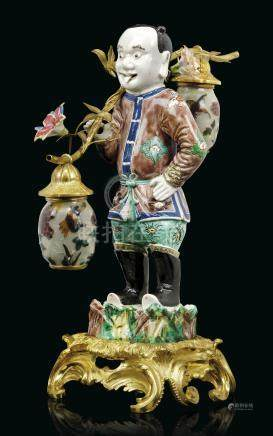 A FRENCH ORMOLU-MOUNTED CHINESE FAMILLE VERTE FIGURE