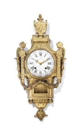 A LATE LOUIS XV ORMOLU CARTEL CLOCK